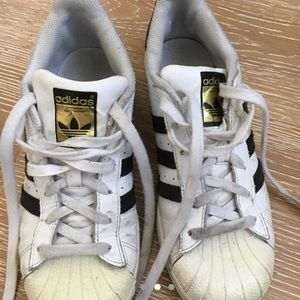 513fdf5e5d4 adidas Shoes - classic adidas superstars black white and gold